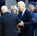Former Vice President Joe Biden. and his wife Jill greet people in front of Summerall Chapel before the start of former U.S. Sen. Ernest