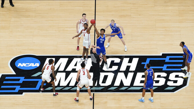 USC forward Evan Mobley (4) and Drake forward Darnell Brodie (51) jump for the tipoff during the first half of a men's college basketball game in the first round of the NCAA tournament at Bankers Life Fieldhouse in Indianapolis, Saturday, March 20, 2021. (AP Photo/Paul Sancya)