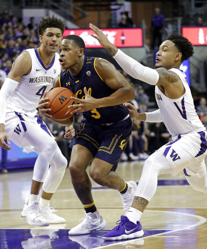 California's Paris Austin (3) drives between Washington's Matisse Thybulle (4) and David Crisp in the first half of an NCAA college basketball game Saturday, Jan. 19, 2019, in Seattle. (AP Photo/Elaine Thompson)