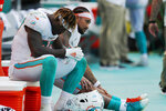 FILE - In this Sept. 8, 2019, file photo, Miami Dolphins running back Kalen Ballage (27) sits on the sideline during the second half at an NFL football game against the Baltimore Ravens, in Miami Gardens, Fla. The Dolphins look like the worst team in the NFL, and might even be the worst team in Miami. On the other hand, a comparison with the Marlins is one matchup the Dolphins might win. (AP Photo/Brynn Anderson, FIle)