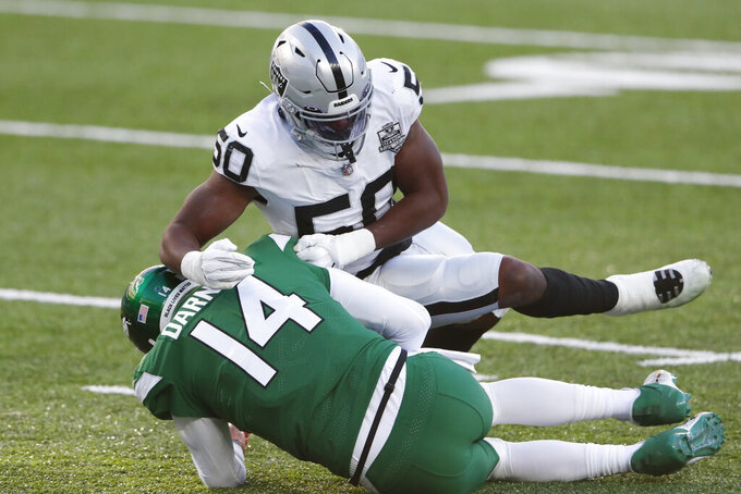 Las Vegas Raiders' Nicholas Morrow, top, sacks New York Jets quarterback Sam Darnold during the second half an NFL football game, Sunday, Dec. 6, 2020, in East Rutherford, N.J. (AP Photo/Noah K. Murray)