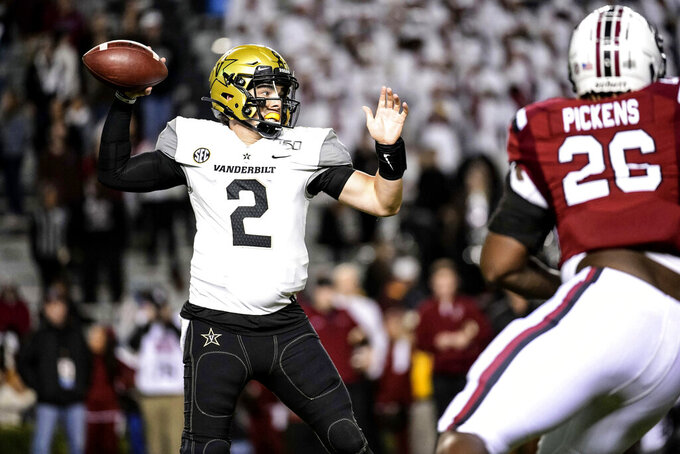 Vanderbilt quarterback Deuce Wallace (2) attempts a pass during the second half of an NCAA college football game against South Carolina, Saturday, Nov. 2, 2019, in Columbia, S.C. (AP Photo/Sean Rayford)