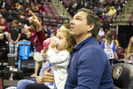 Florida Gov. Ron DeSantis and his daughter Madison, 3, watch the first half of an NCAA college basketball game between Florida State and Georgia Tech in Tallahassee, Fla., Tuesday, Dec. 31, 2019. (AP Photo/Mark Wallheiser)