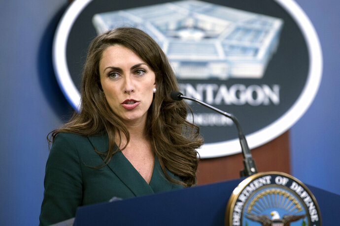 In this March 25, 2020 provided by the Department of Defense, Pentagon Press Secretary Alyssa Farah briefs the press on the department's COVID-19 response efforts, at the Pentagon in Washington. White House press secretary Stephanie Grisham is leaving her post nine months into the job after never holding a single press briefing.  She will be replaced by two women who are familiar names in Trump world. Trump campaign spokeswoman Kayleigh McEnany will be joining the administration as press secretary, while Pentagon spokeswoman Alyssa Farah will be moving to the White House in a strategic communications role. (Lisa Ferdinando/Department of Defense via AP)