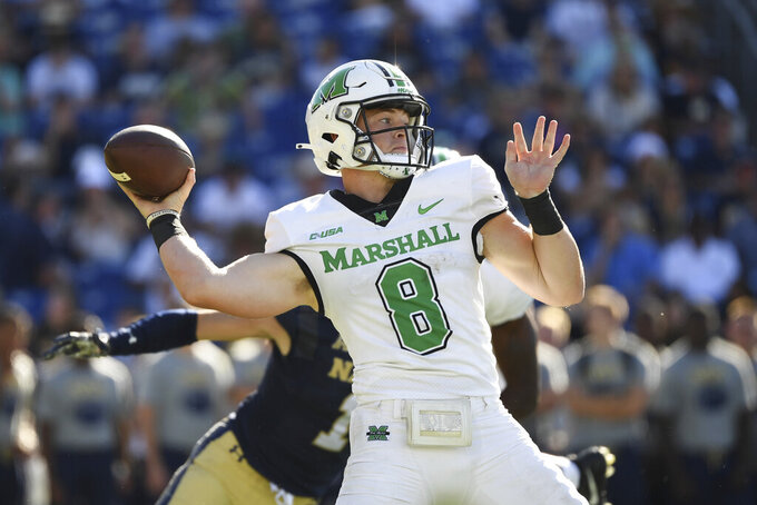Marshall quarterback Grant Wells (8) throws the ball during the first half of an NCAA college football game against Navy, Saturday, Sept. 4, 2021, in Annapolis, Md. (AP Photo/Terrance Williams)