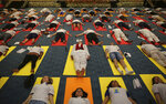 Diplomats of various countries perform yoga to mark International Yoga Day in New Delhi, India, Friday, June 21, 2019. Prime Minister Narendra Modi successfully lobbied the United Nations to designate June 21 International Yoga Day in his first year in power in 2014. Most of India's 191 embassies and consulates worldwide organized yoga sessions to commemorate the day, according to the foreign ministry. (AP Photo/Altaf Qadri)