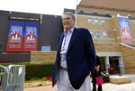 FILE - This Oct. 1, 2012 file photo shows moderator Jim Lehrer outside Magness Arena, site of a presidential debate on the campus of the University of Denver in Denver. PBS announced that PBS NewsHour's Jim Lehrer died Thursday, Jan. 23, 2020, at home. He was 85. (AP Photo/Charlie Neibergall, File)
