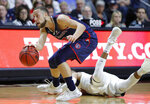 "FILE - In this March 12, 2019, file photo, St. Mary's Jordan Ford dribbles around a Gonzaga player during the second half of an NCAA college basketball game in the championship pf the West Coast Conference tournament in Las Vegas. Saint Mary's certainly wasn't supposed to beat No. 1 Gonzaga last week to steal away the West Coast Conference tournament title and automatic NCAA bid. ""We know that we can beat anybody,"" leading scorer Jordan Ford said. ""Since we beat the No. 1 team in the country, and to be able to see and play against the No. 1 team in the country three times this year, we know that we can hang with anybody."" (AP Photo/John Locher, File)"