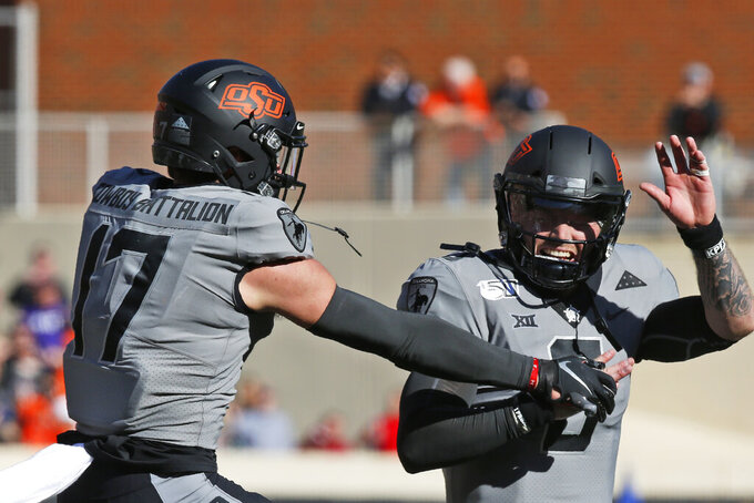 Oklahoma State wide receiver Dillon Stoner (17) celebrates his touchdown with quarterback Dru Brown, right, in the second half of an NCAA college football game against Kansas in Stillwater, Okla., Saturday, Nov. 16, 2019. (AP Photo/Sue Ogrocki)