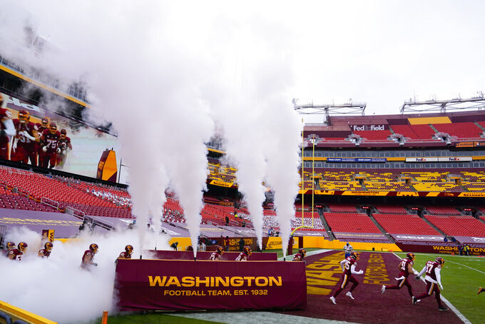 Members of the Washington Football Team take the filed before the start of the first half of an NFL football game against the Seattle Seahawks, Sunday, Dec. 20, 2020, in Landover, Md. (AP Photo/Susan Walsh)