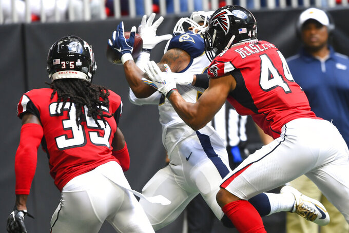 Los Angeles Rams running back Todd Gurley (30) makes a touchdown catch against Atlanta Falcons' Vic Beasley (44) and Jamal Carter (35) during the first half of an NFL football game, Sunday, Oct. 20, 2019, in Atlanta. (AP Photo/John Amis)