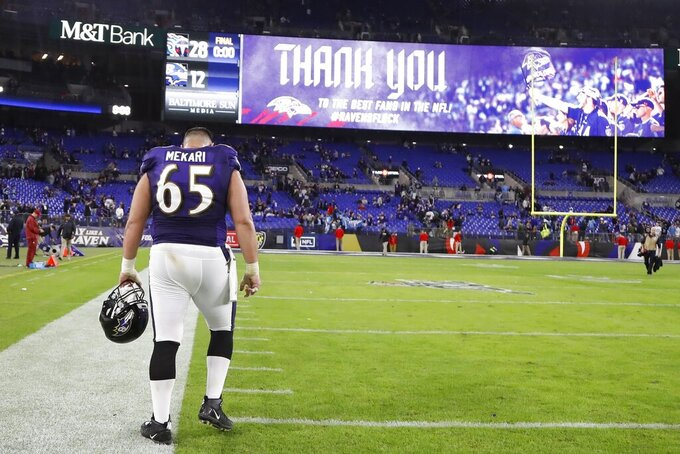 Baltimore Ravens offensive guard Patrick Mekari (65) leaves the field after an NFL divisional playoff football game against the Tennessee Titans, Saturday, Jan. 11, 2020, in Baltimore. The Titans won 28-12. (AP Photo/Julio Cortez)