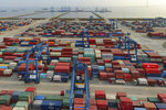 FILE - In this April 8, 2021, file photo, a container port on the Yangtze River is seen in an aerial view in Nantong in eastern China's Jiangsu province. China's exports surged nearly 28% in May 2021 while imports jumped 51% as demand rebounded in the U.S. and other markets where the pandemic is waning, though growth is leveling off after a stunning recovery from last year's slump. (Chinatopix via AP, File)