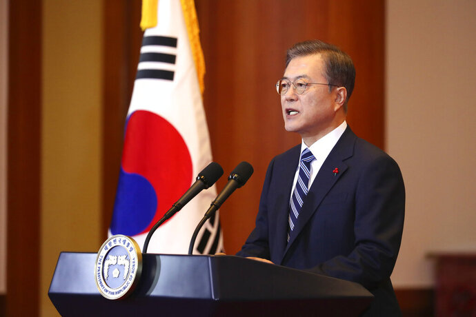 South Korean President Moon Jae-in speaks during his New Year's speech at the presidential Blue House in Seoul, South Korea, Tuesday, Jan. 7, 2020. Moon said he hopes to see North Korean leader Kim Jong Un fulfill a promise to visit the South this year as he called for the rival Koreas to end a prolonged freeze in bilateral relations. (Lee Jin-wook/Yonhap via AP)