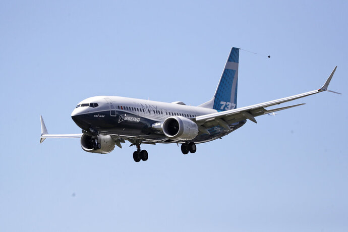 A Boeing 737 MAX jet heads to a landing at Boeing Field following a test flight Monday, June 29, 2020, in Seattle. The jet took off from Boeing Field earlier in the day, the start of three days of re-certification test flights that mark a step toward returning the aircraft to passenger service. The Federal Aviation Administration test flights over the next three days will evaluate Boeing's proposed changes to the automated flight control system on the MAX, a system that activated erroneously on two flights that crashed, killing 346 people. (AP Photo/Elaine Thompson)