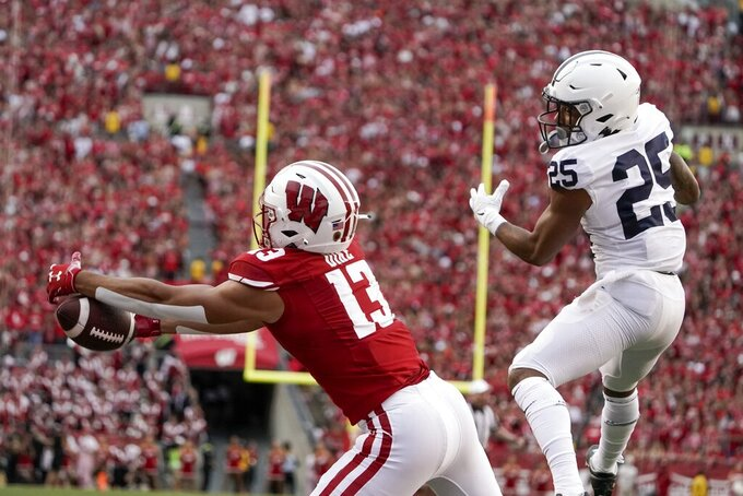 Wisconsin's Chimere Dike drops a pass in the end zone in front of Penn State's Daequan Hardy during the second half of an NCAA college football game Saturday, Sept. 4, 2021, in Madison, Wis. Penn State won 16-10. (AP Photo/Morry Gash)