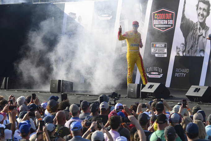 Joey Logano is introduced before a NASCAR Cup Series auto race Sunday, Sept. 5, 2021, in Darlington, S.C. (AP Photo/John Amis)