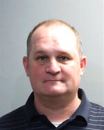 A photo provided by the Oakland County Sheriff's Office shows Eric Wuestenberg. Wuestenberg and his wife, Jillian Wuestenberg, were arrested after at least one handgun was pulled on a Black woman and her daughters during a videotaped confrontation in a restaurant parking lot in Orion Township, Mich., authorities said Thursday, July 2, 2020. The two were charged Thursday with felonious assault, Oakland County Prosecutor Jessica Cooper said in a release. (Oakland County Sheriff's Office via AP)
