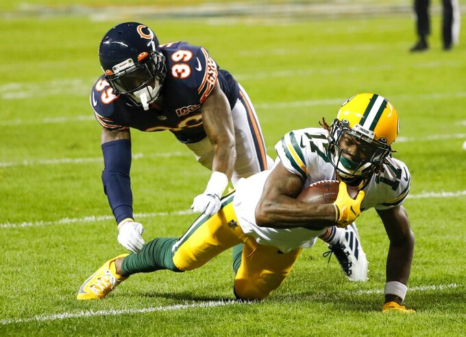 Green Bay Packers' Davante Adams is stopped by Chicago Bears' Eddie Jackson during the first half of an NFL football game Thursday, Sept. 5, 2019, in Chicago. (AP Photo/Charles Rex Arbogast)