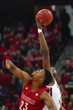 Virginia Tech guard Landers Nolley II (2) and Louisville center Steven Enoch (23) battle for the tip-off at the start of an NCAA college basketball game, Sunday, March 1, 2020, in Louisville, Ky. (AP Photo/Bryan Woolston)