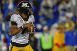 Missouri quarterback Kelly Bryant (7) drops back to pass the ball during the first half of NCAA college football game against Kentucky, Saturday, Oct. 26, 2019, in Lexington, Ky. (AP Photo/Bryan Woolston)