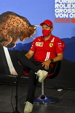 Ferrari driver Sebastian Vettel of Germany speaks during drivers news conference the at the Red Bull Ring racetrack in Spielberg in Spielberg, Austria, Thursday, July 2, 2020. Austrian Formula One Grand Prix will be held on Sunday. (Mark Sutton/Pool via AP)