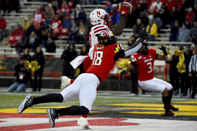Nebraska wide receiver JD Spielman (10) makes a catch for a touchdown in front of Maryland defensive back Jordan Mosley (18) during the first half of an NCAA college football game, Saturday, Nov. 23, 2019, in College Park, Md. (AP Photo/Will Newton)