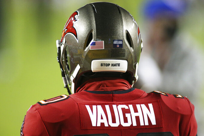 """FILE - In this Jan. 9, 2021, file photo, Tampa Bay Buccaneers running back Ke'Shawn Vaughn wears a helmet with the message """"Stop Hate"""" before the team's NFL wild-card playoff football game against the Washington Football Team in Landover, Md. NFL players can wear social justice messages on their helmets again this season and """"It Takes All of Us"""" and """"End Racism"""" will be stenciled in end zones for the second straight year as part of the league's Inspire Change platform. (AP Photo/Daniel Kucin Jr., File)"""