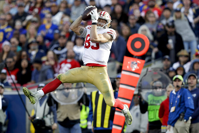 FILE - In this Dec. 30, 2018, file photo, San Francisco 49ers tight end George Kittle catches a pass against the Los Angeles Rams during the first half in an NFL football game in Los Angeles. Kittle had 1,377 yards receiving, setting a new record at the position.(AP Photo/Marcio Jose Sanchez, File)