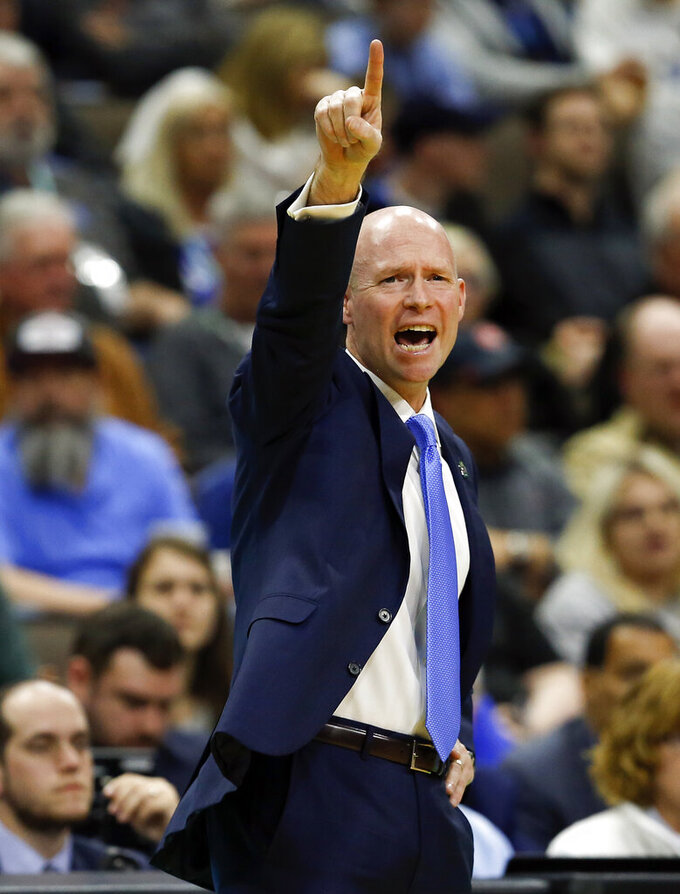 Seton Hall coach Kevin Willard gestures during the first half of a first-round game against Wofford in the NCAA men's college basketball tournament in Jacksonville, Fla., Thursday, March 21, 2019. (AP Photo/Stephen B. Morton)