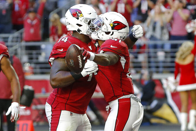 Arizona Cardinals running back Kenyan Drake, right, celebrates his touchdown against the Cleveland Browns with Arizona Cardinals wide receiver Damiere Byrd during the first half of an NFL football game, Sunday, Dec. 15, 2019, in Glendale, Ariz. (AP Photo/Rick Scuteri)