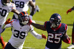 Houston Texans' Duke Johnson (25) is chased by Chicago Bears' Eddie Jackson (39) during the first half of an NFL football game, Sunday, Dec. 13, 2020, in Chicago. (AP Photo/Nam Y. Huh)