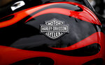 FILE- This April 27, 2017, file photo shows the Harley-Davidson name on the gas tank of a bike in Northbrook, Ill. The European Union will start taxing on Friday, June 22, 2018, a range of imports from the U.S., including quintessentially American goods like Harley-Davidson bikes and cranberries, in response to President Donald Trump's decision to slap tariffs on European steel and aluminum. (AP Photo/Nam Y. Huh, File)