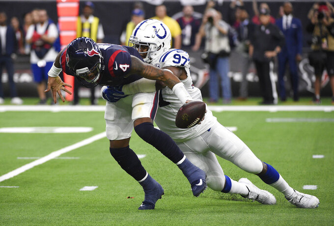 Houston Texans quarterback Deshaun Watson (4) is sacked by Indianapolis Colts defensive tackle Al-Quadin Muhammad (97) during the first half of an NFL wild card playoff football game, Saturday, Jan. 5, 2019, in Houston. (AP Photo/Eric Christian Smith)