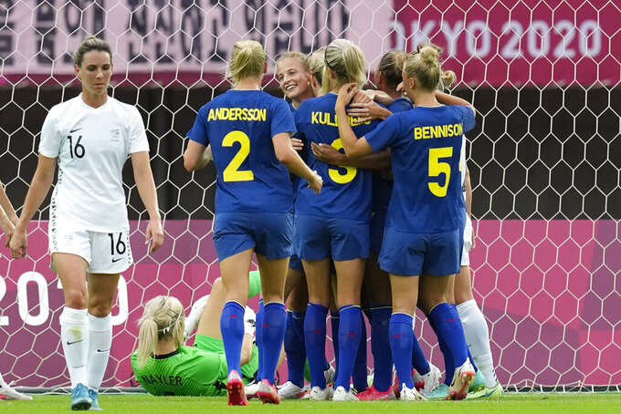 Sweden's Anna Anvegard celebrates with her teammates after scoring on a header against New Zealand during a women's soccer match between New Zealand and Sweden at the 2020 Summer Olympics, Tuesday, July 27, 2021, in Rifu, Japan. (AP Photo/Andre Penner)