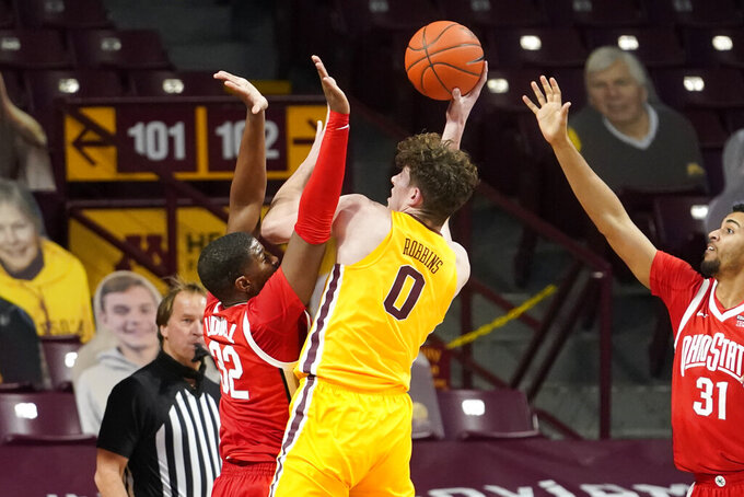 Minnesota's Liam Robbins (0) shoots as Ohio State's E.J. Liddell (32) defends in the second half of an NCAA college basketball game Sunday, Jan. 3, 2021, in Minneapolis. (AP Photo/Jim Mone)