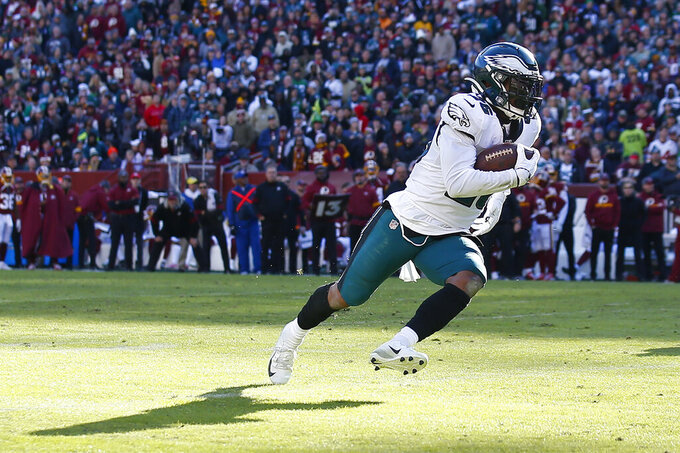Philadelphia Eagles running back Miles Sanders (26) runs in for a touchdown against the Washington Redskins in the first half of an NFL football game, Sunday, Dec. 15, 2019, in Landover, Md. (AP Photo/Alex Brandon)