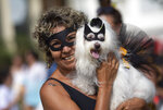 A woman poses with her dog Kiara during the