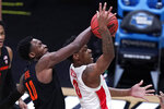 Oregon State forward Warith Alatishe (10) blocks a shot by Houston guard Marcus Sasser (0) during the first half of an Elite 8 game in the NCAA men's college basketball tournament at Lucas Oil Stadium, Monday, March 29, 2021, in Indianapolis. (AP Photo/Michael Conroy)
