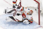 Calgary Flames goaltender Cam Talbot (39) is scored on by the Dallas Stars during the first period of an NHL hockey Stanley Cup first-round playoff series, Thursday, Aug. 13, 2020, in Edmonton, Alberta. (Jason Franson/The Canadian Press via AP)