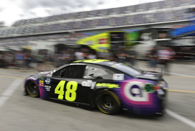 Jimmie Johnson (48) drives out of the garages to the track during NASCAR auto racing practice at Daytona International Speedway, Saturday, Feb. 16, 2019, in Daytona Beach, Fla. (AP Photo/John Raoux)