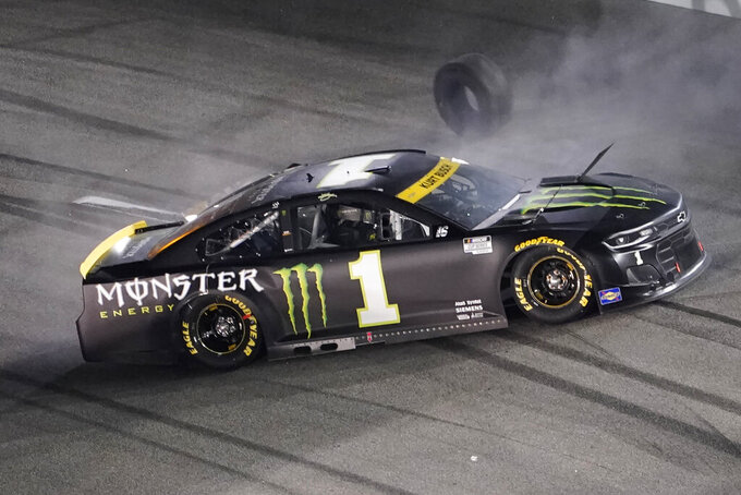 Kurt Busch loses a tire and spins during the NASCAR Cup series auto race in Richmond, Va., Saturday, Sept. 11, 2021. (AP Photo/Steve Helber)