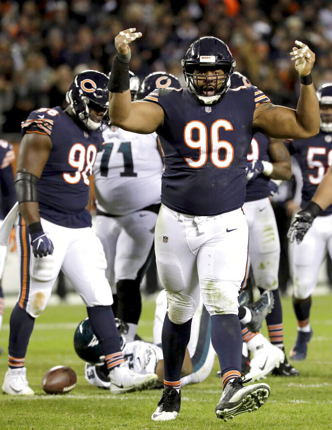 FILE - In this Sunday, Jan. 6, 2018, file photo, Chicago Bears defensive end Akiem Hicks (96) reacts after tackling Philadelphia Eagles running back Darren Sproles during the second half of an NFL wild-card playoff football game in Chicago. The Chicago Bears announced Tuesday, April 23, 2019, that veteran defensive tackle Akiem Hicks and rookie linebacker Roquan Smith were selected by their teammates as the 2018 Piccolo Award winners. The Piccolo Award has been given to a Bears rookie every season since 1970 in memory of Brian Piccolo. In 1992, the award was expanded to include a veteran as well.  (AP Photo/Nam Y. Huh, File)