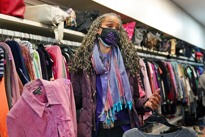 New York City mayoral candidate Maya Wiley shops in a thrift store before getting a tour of the Little Sisters of the Assumption Family Health Service in New York, Friday, Feb. 12, 2021. Wiley joins a crowded Democratic primary field that includes longtime elected officials and veterans of the administration of Mayor Bill de Blasio, who is barred by the city charter from seeking a third term. The Democratic mayoral primary is scheduled for June 22. (AP Photo/Seth Wenig)