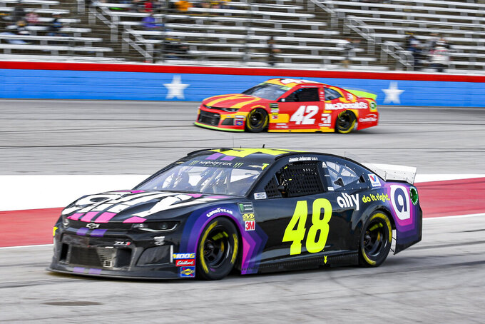 Jimmie Johnson (48) enters pit road during a NASCAR Cup Series auto race at Texas Motor Speedway, Sunday, Nov. 3, 2019, in Fort Worth, Texas. (AP Photo/Randy Holt)
