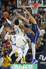 Utah Jazz guard Donovan Mitchell (45) goes to the basket as Dallas Mavericks forward Maxi Kleber (42) defends in the first half during an NBA basketball game Saturday, Jan. 25, 2020, in Salt Lake City. (AP Photo/Rick Bowmer)