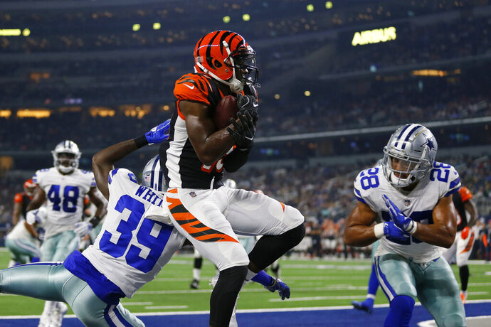 File-This Aug. 18, 2018 file photo shows Cincinnati Bengals wide receiver John Ross, center, making a catch to complete a two point conversion between Dallas Cowboys cornerback Marquez White (39) and safety Jameill Showers (28) during a preseason NFL Football game in Arlington, Texas. Ross returns this week from a shoulder injury, giving the Cincinnati Bengals the deep threat they've lacked. He was injured during a Monday night game in Pittsburgh. (AP Photo/Roger Steinman, File)
