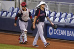 Boston Red Sox catcher Christian Vazquez, left, and starting pitcher Tanner Houck, right, walk to the dugout before a baseball game against the Miami Marlins, Tuesday, Sept. 15, 2020, in Miami. (AP Photo/Lynne Sladky)