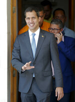 National Assembly President Juan Guaido, who declared himself interim president of Venezuela, arrives to lead a session of the opposition-controlled assembly in Caracas, Venezuela, Monday, March 11, 2019. An explosion rocked a power station Monday in the Venezuelan capital, witnesses said, adding to the crisis created by days of nationwide power cuts, while Guaido has blamed the blackouts that began Thursday on alleged government corruption and mismanagement. (AP Photo/Eduardo Verdugo)