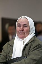 A relative of victims of the Srebrenica genocide cries as she hears the news on the decision of the UN appeals judges on former Bosnian Serb leader Radovan Karadzic in Potocari, Bosnia and Herzegovina, Wednesday, March 20, 2019. United Nations appeals judges on Wednesday upheld the convictions of Karadzic for genocide, war crimes and crimes against humanity, and increased his sentence from 40 years to life imprisonment. (AP Photo/Marko Drobnjakovic)